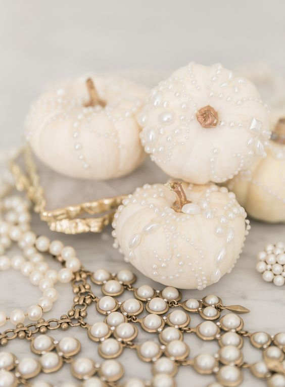 white natural pumpkins with copper stems and shiny pearls for detailing are amazing for glam Halloween decor