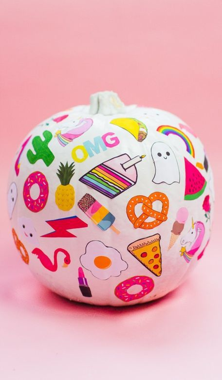 a pink pumpkin with colorful stickers is a cool and easy idea to decorate your pumpkin for Halloween in no time