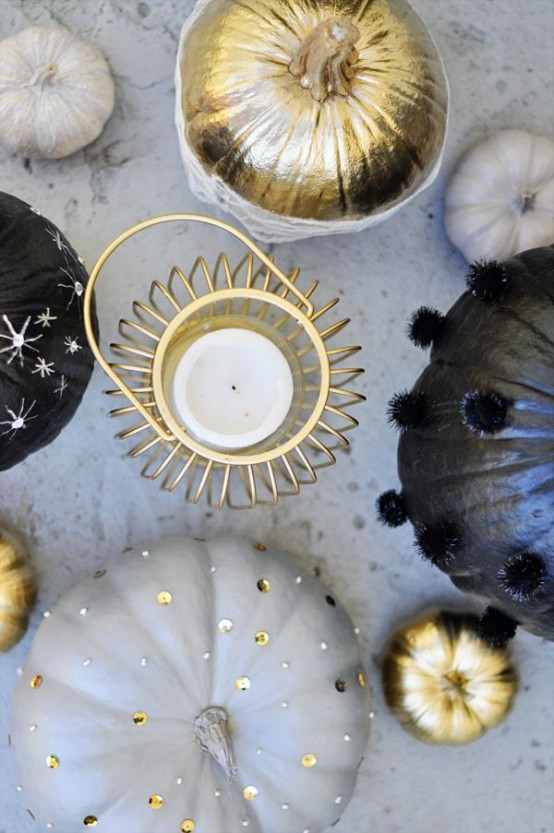 black, gold and grey pumpkins decorated with gold sequins, silver stars and fluffy pompoms for Halloween