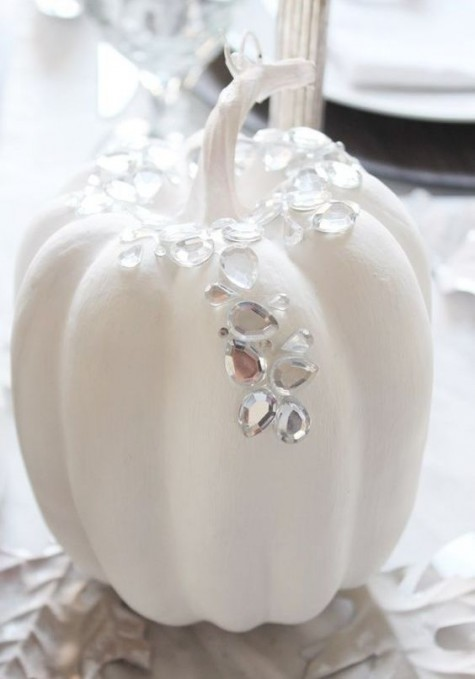 a white pumpkin with large crystal patterns on it is a very chic and cool idea, non-typical for Halloween