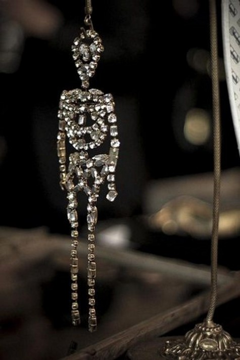 a crystal skeleton to hang on the door or mirror is a pretty and cool decoration for Halloween