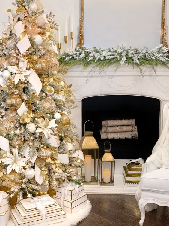 a snowy Christmas tree with large gold ornaments, ribbons and foliage plus white ornaments and ribbons