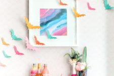 17 colorful paper bats, bright vases and bottles, a bright artwork and colorful bottles will make your bar space amazing