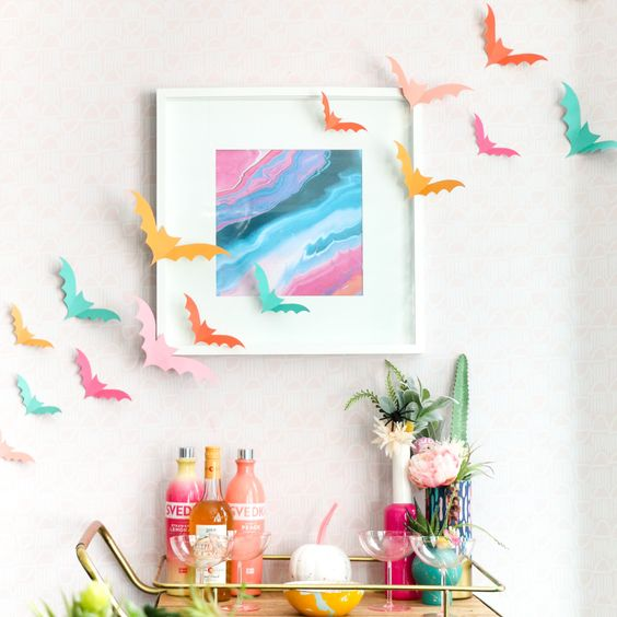 colorful paper bats, bright vases and bottles, a bright artwork and colorful bottles will make your bar space amazing