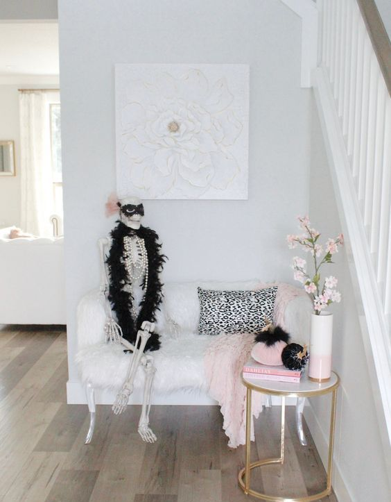 a glam Halloween entry with a skeleton in pearls and a mask, some touches of black and pink