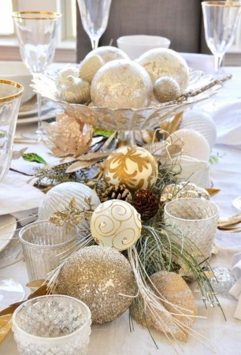 gold glitter and silver Christmas ornaments and candleholders are amazing for Christmas table decor