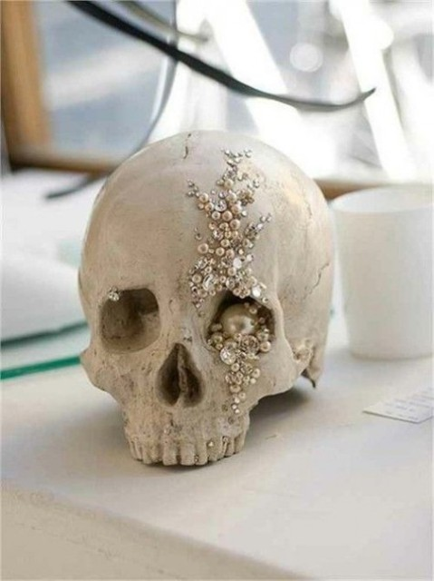 a glam skull wtih pearls, beads, rhinestones and sequins is a gorgeous scary decoration to make