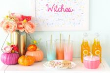 20 a colorful Halloween drink bar with bright pumpkins, ombre glasses and a sprinkle sign, a lush floral centerpiece