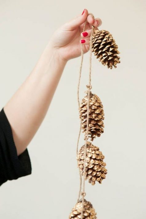 a gold pinecone garland is great for rustic and glam Christmas decor   make it yourself