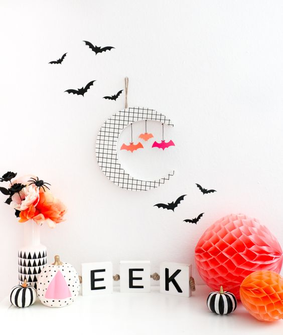 black and white Halloween decor spruced up with orange and pink details for a fun touch
