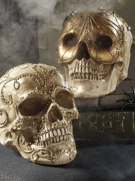 glam gold and champagne-colored skulls with beading will be great decorations for mantels, shelves and food stations