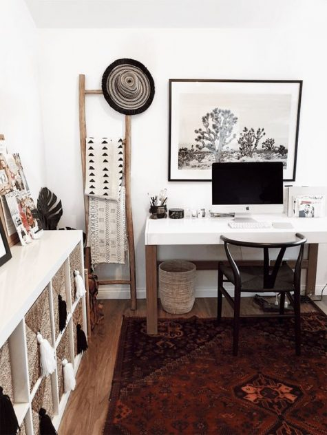 a boho Scandi home office with a boho rug, baskets, printed textiles and tassels and a sleek white desk