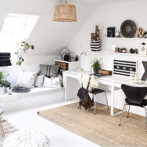 a cool shared boho home office in black and white, a jute rug, stripes, pillows and open shelving with objects on display