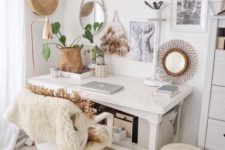 a cozy boho home office nook with a monochromatic gallery wall, mirrors, faux fur, fringe and baskets