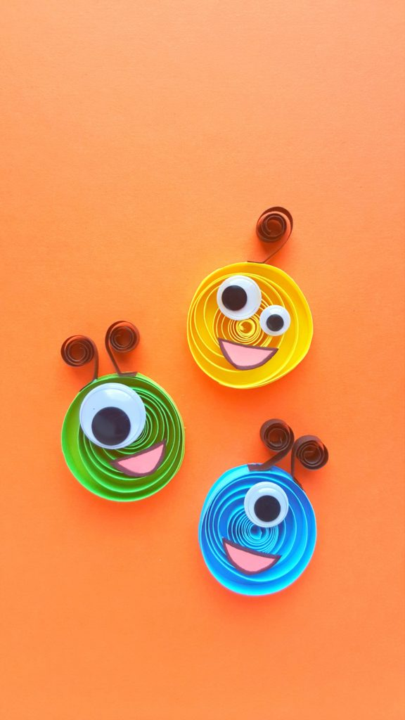 DIY colorful quilling monsters with googly eyes (via whisperedinspirations.com)