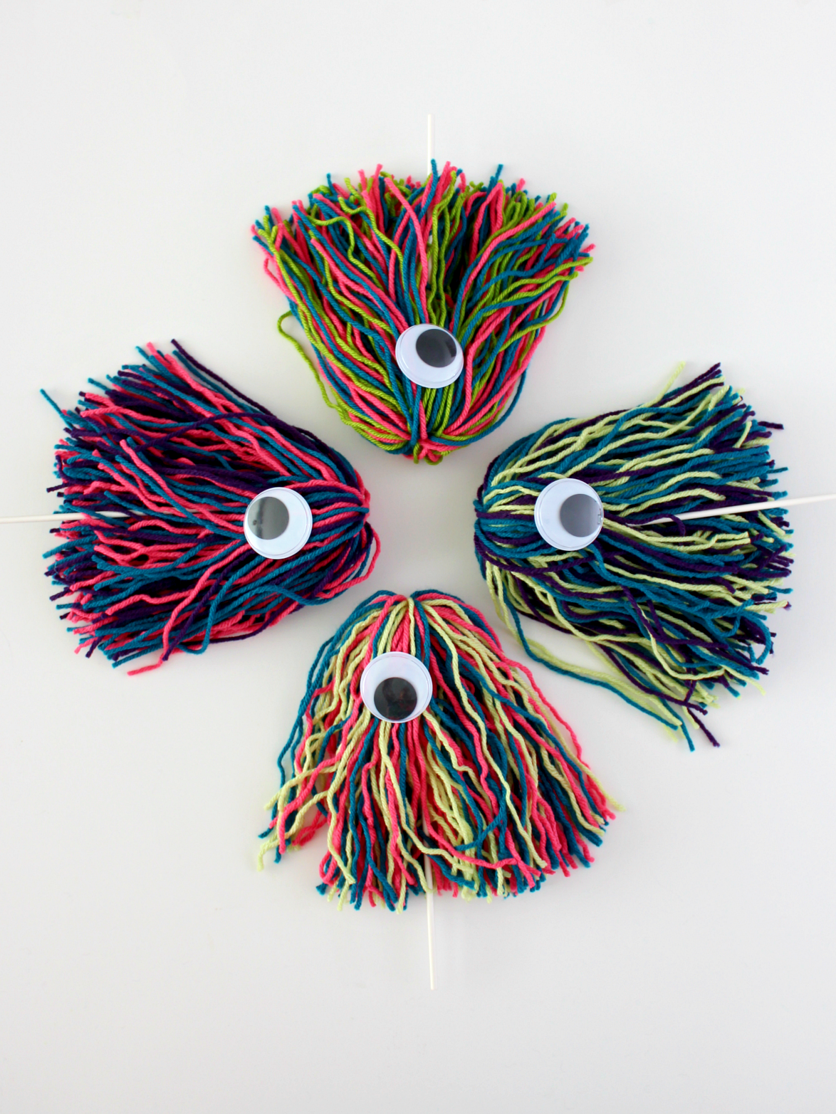 DIY colorful yarn Halloween monster puppets