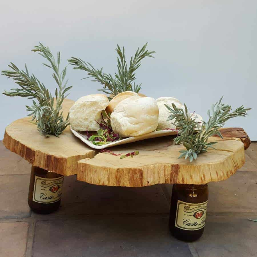 DIY bottles and a wood slice centerpiece