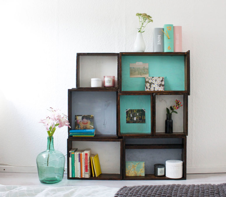DIY wooden box shelving unit composed of several boxes (via www.itsprettynice.com)