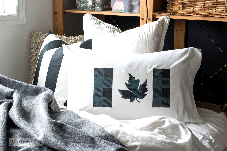 DIY stenciled buffalo check pillow with a leaf