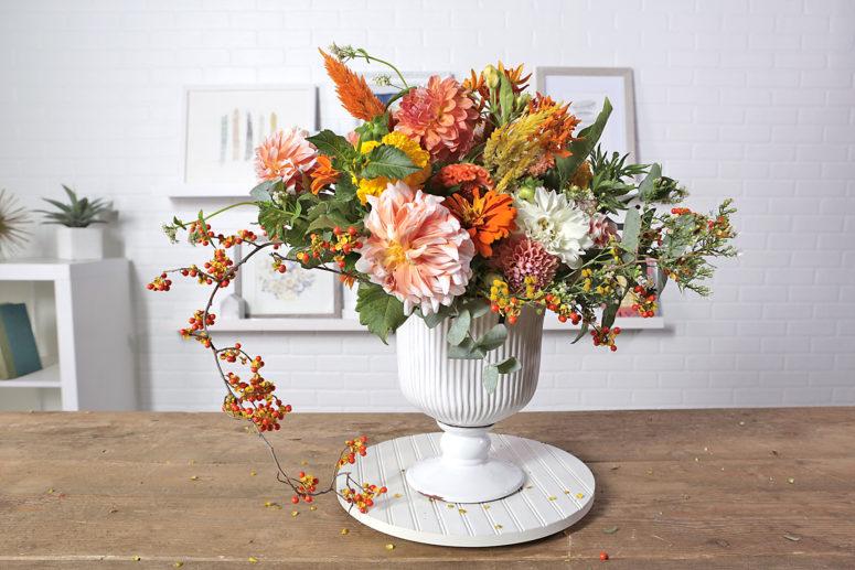 DIY vintage-inspired marigold and orange Thanksgiving floral arrangement (via www.bhg.com)