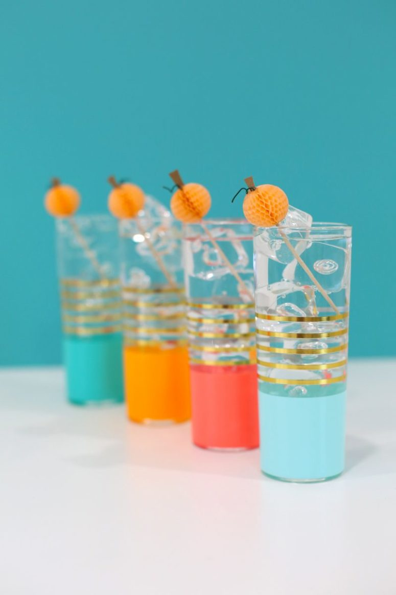 DIY paper honeycomb drink stirrers for Halloween (via lovelyindeed.com)
