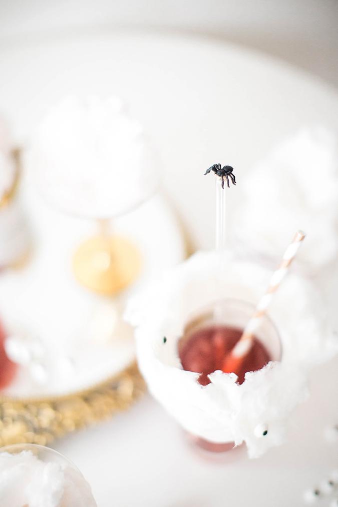 DIY Halloween spider cocktail stirrers (via laurenconrad.com)