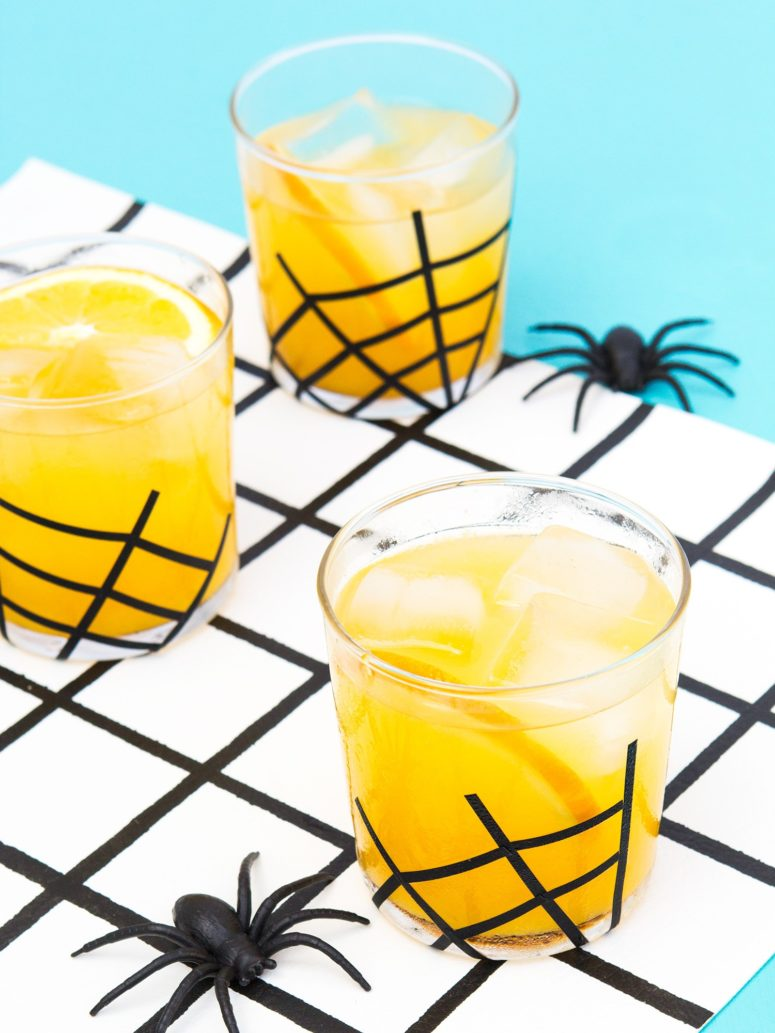 DIY easy and fast Halloween spiderweb glasses (via sarahhearts.com)