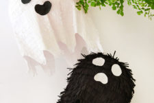 DIY black and white ghost pinatas for Halloween