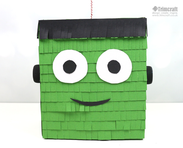 DIY bold Frankenstein pinata for kids' Halloween parties (via www.thecraftblog.com)