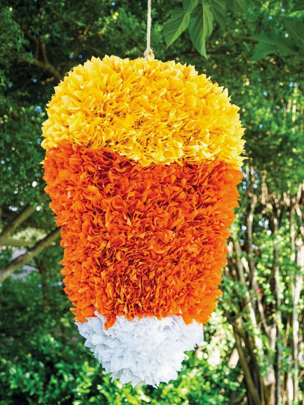 DIY colorful candy corn pinata for Halloween (via www.hgtv.com)