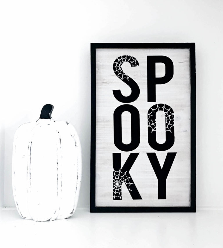 DIY stylish black and white Halloween sign with spiderwebs (via kaylamakes.com)