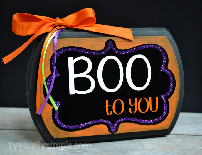 DIY colorful Halloween sign with bright colors and bows (via typicallysimple.com)