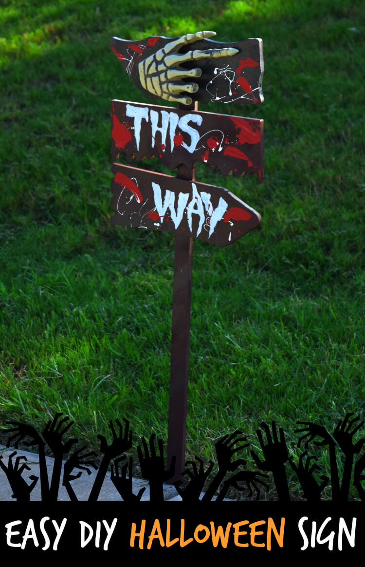 DIY scary Halloween sign with blood and a skeleton hand (via thetiptoefairy.com)