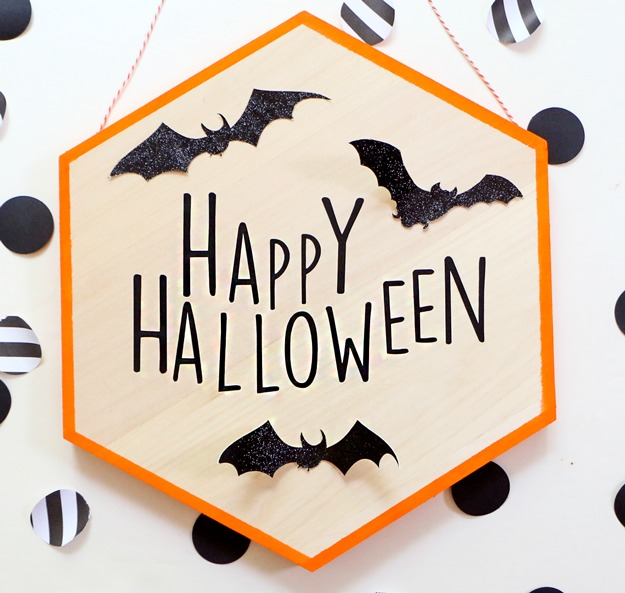 DIY modern hexagon Halloween sign with bats (via happinessiscreating.com)