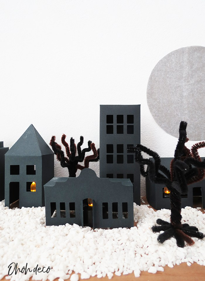 DIY paper haunted village with 5 different house designs (via www.ohohdeco.com)