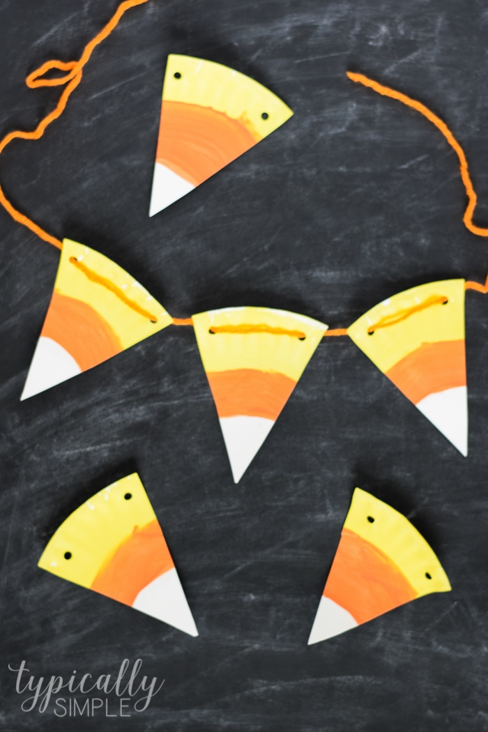 DIY paper plate candy corn Halloween bunting (via typicallysimple.com)