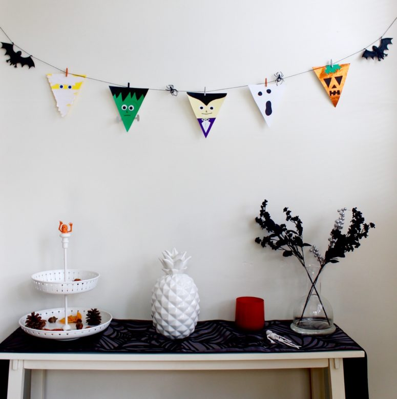 DIY colorful Halloween bunting flags for a kids' party (via popcornandchocolate.com)