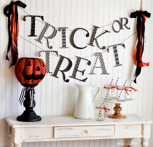 DIY Halloween bunting with Trick or Treat letters (via www.ellaclaireinspired.com)