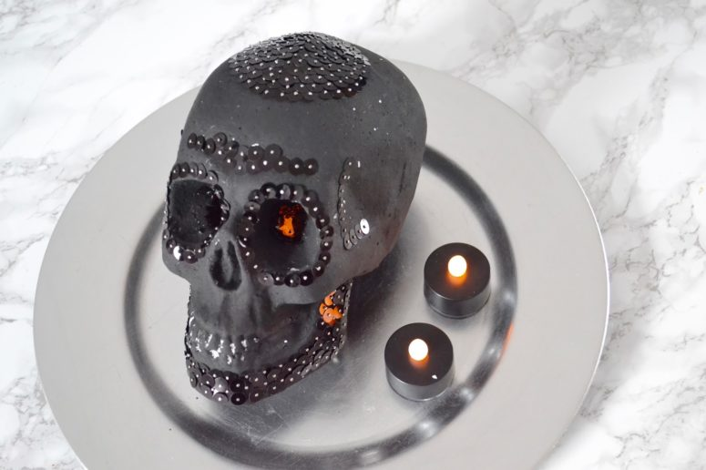 DIY matte black skull with blakc sequin decor for Halloween (via thethingsshemakes.blogspot.com)