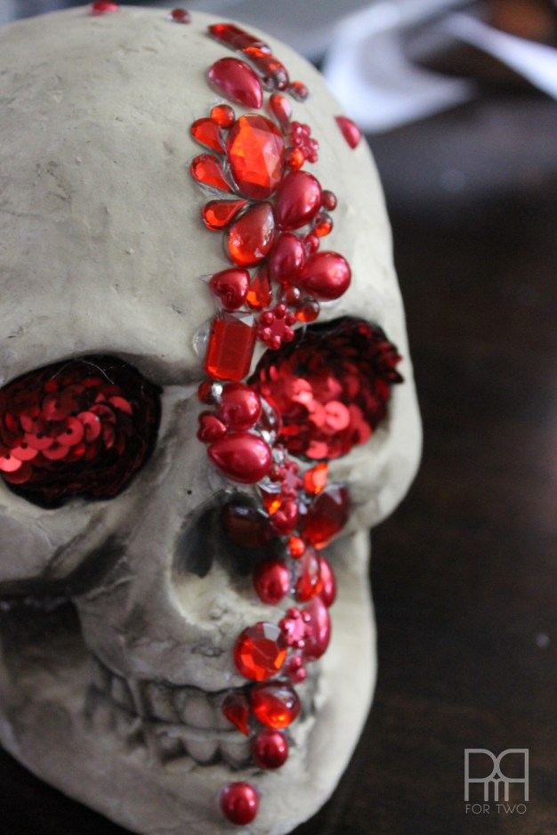 DIY jeweled skull with bright red rhinestones and beads (via www.pmqfortwo.com)