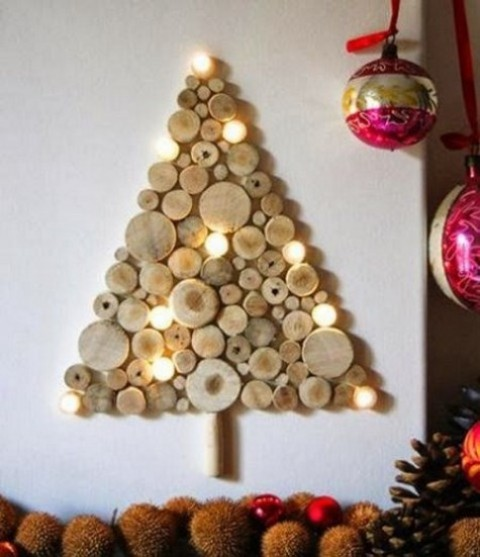 a wall-mounted wood slice Christmas tree with lights is a great rustic idea that brings coziness