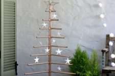 03 a copper pipe Christmas tree with white star ornaments is a unique and creative alternative to a usual Christmas tree