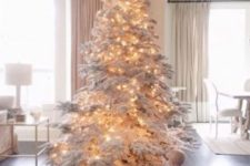 03 a large flocked Christmas tree with lights – you don't need any ornaments for a gorgeous and fairy-tale look