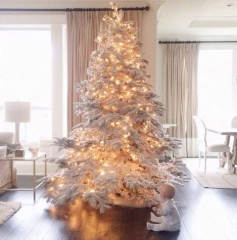 a large flocked Christmas tree with lights – you don't need any ornaments for a gorgeous and fairy tale look