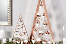 04 A-frame ornament Christmas trees in copper and white look very chic and stylish and make up a cool alternative to a usual Christmas tree
