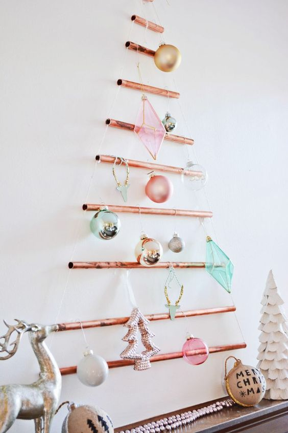 a wall-mounted copper pipe Christmas tree with colorful ornaments is a creative alternative to a usual one