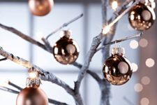 06 matte and glossy copper Christmas ornaments will make your tree or just branches stand out with a warm glow