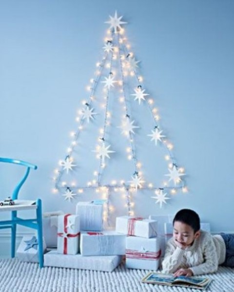 a star light garland forming a wall-mounted Christmas tree doesn't require any ornaments at all