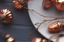 07 vintage-inspired copper Christmas ornaments on brown ribbons will give warm glow to your tree and a slight refined vintage feel
