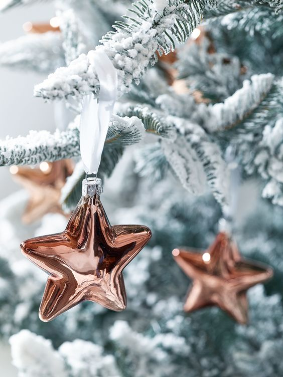 cute copper star Christmas ornaments will stand out on any Christmas tree and will add a trendy touch to the space